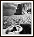 1957__ear_on_beach_
