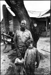 bruce-davidson-subwayphotography-1980 MR-HARALSON-AND-HIS-SONS-IRA-AND-ISAIAH-IN-FRONT-OF-THEIR-CABIN-SELMA-ALABAMA-1965-2-C30610